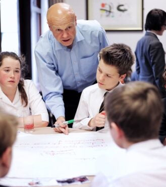 David Gibson of Short Richardson Forth Solicitors talking with pupils from Durham Johnson School at a Future Business Magnates challenge event at the Lindisfarne Centre, Durham University. Picture by Stuart Boulton.